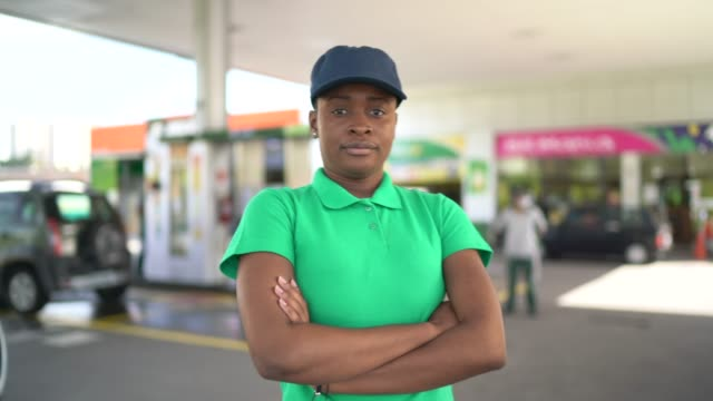 Portrait of displeased female gas station attendant at work