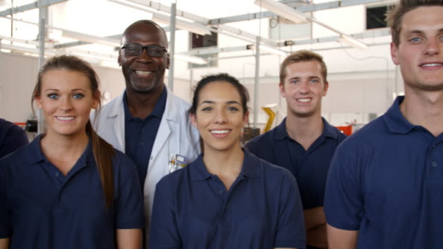 Portrait Of Engineer With Apprentice Students In Workshop video
