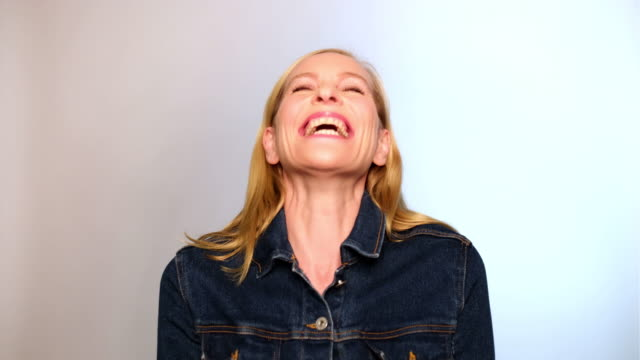 Portrait of excited mature woman laughing