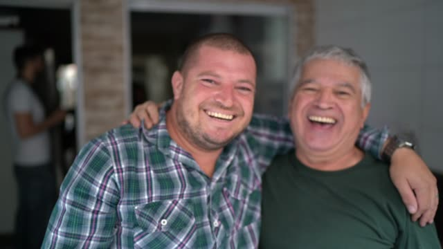 Portrait of father and son / friendship embracing