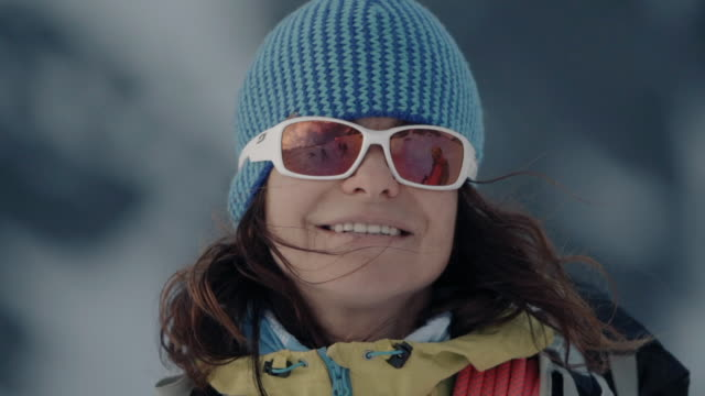 Portrait of female alpinist on mountain with sunglasses