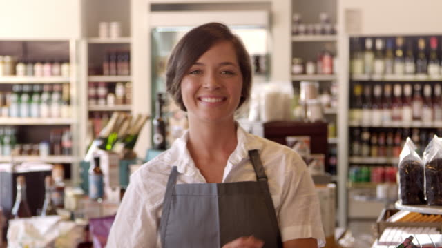 Portrait Of Female Employee In Delicatessen Shot On R3D - vídeo