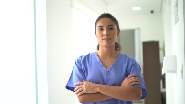Portrait of female nurse at hospital Portrait of female nurse at hospital bolos stock videos & royalty-free footage