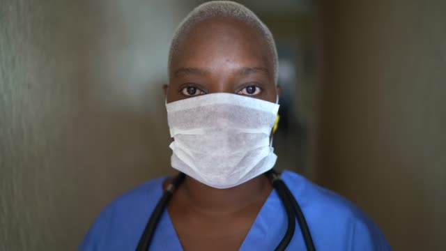 Portrait of female nurse with face mask video