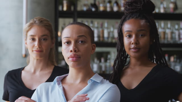 Portrait Of Female Owner Of Restaurant Bar With Team Of Female Waiting Staff Standing By Counter