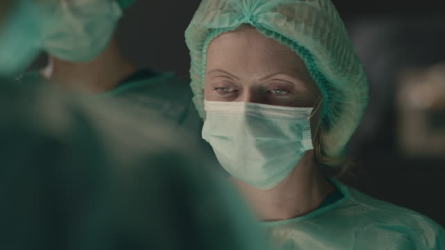 Portrait of female surgeon performing surgical operation video