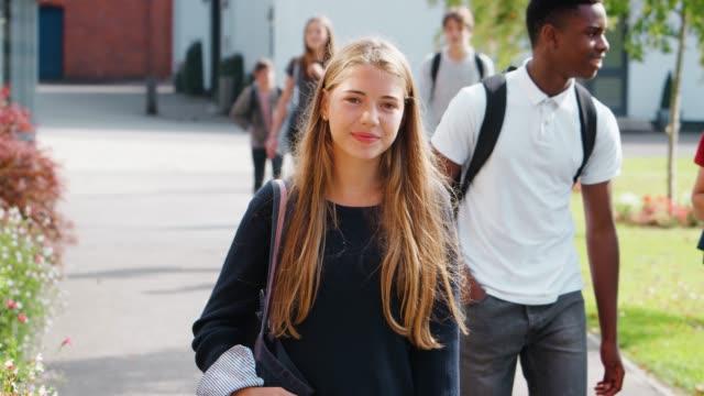 Portrait Of Female Teenage Student Walking Around College Campus video