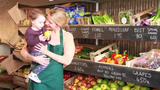 Portrait of female with child in organic shop video