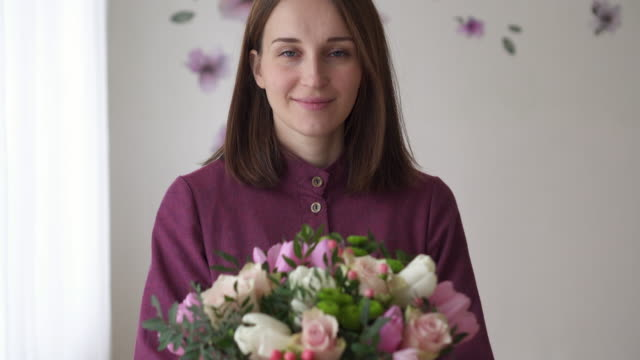 Portrait of florist woman with bouquet made by her