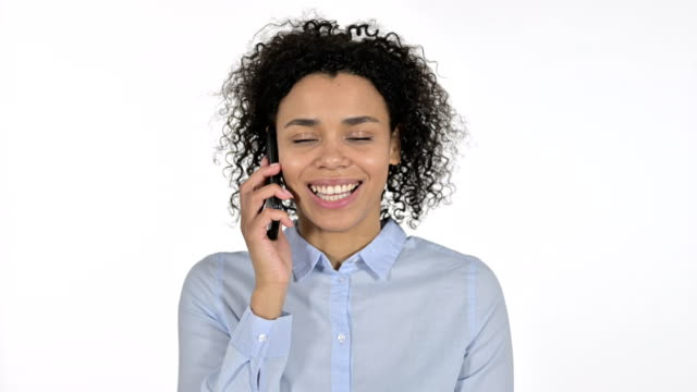 Portrait of Focused Young African Woman Talking on Smartphone