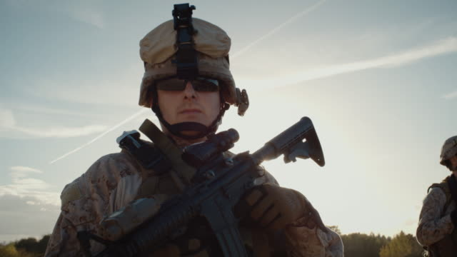 Portrait of Fully Equipped Solder Holding Assault Rifle and Standing in the Desert Environment video