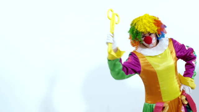 Portrait of funny clown showing his great scissors video