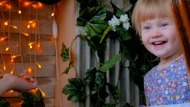 Portrait of funny little girl at home Portrait of funny little girl at home. Family, childhood and leisure concept pigtails stock videos & royalty-free footage