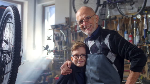 SLO MO Portrait of grandfather and grandson in the workshop video