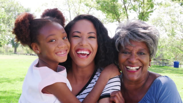 Portrait Of Grandmother With Adult Daughter And Granddaughter Relaxing In Park Portrait Of Grandmother With Adult Daughter And Granddaughter Relaxing In Park granddaughter stock videos & royalty-free footage