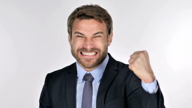 Portrait of Handsome Businessman Celebrating Success
