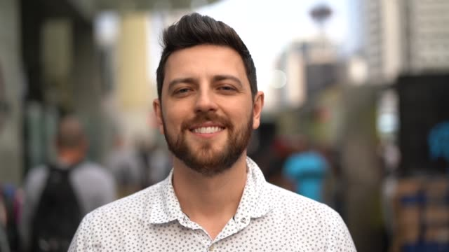 Portrait of handsome man standing in the street Portrait of handsome man handsome people stock videos & royalty-free footage