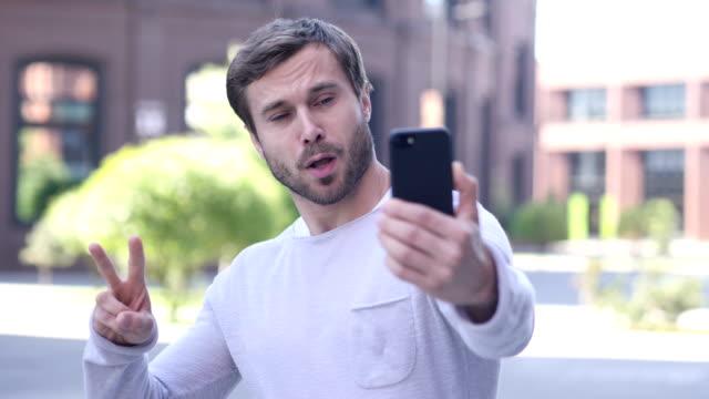 Portrait of Handsome Man Taking Selfie on Phone video