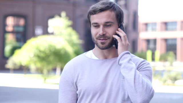 Portrait of Handsome Man Talking on Phone video