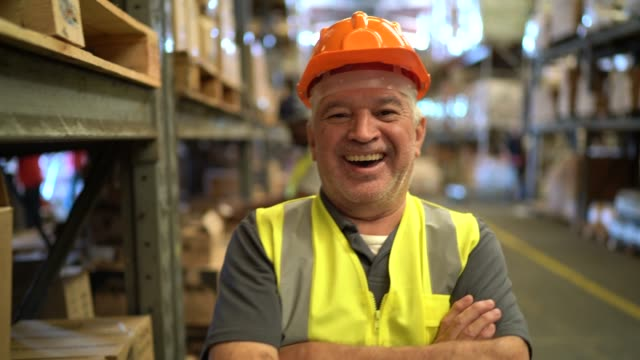 Portrait of happy and smiling worker at warehouse Portrait of happy and smiling worker at warehouse manufacturing occupation stock videos & royalty-free footage