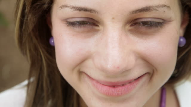 Portrait of happy beautiful young woman looking at camera video