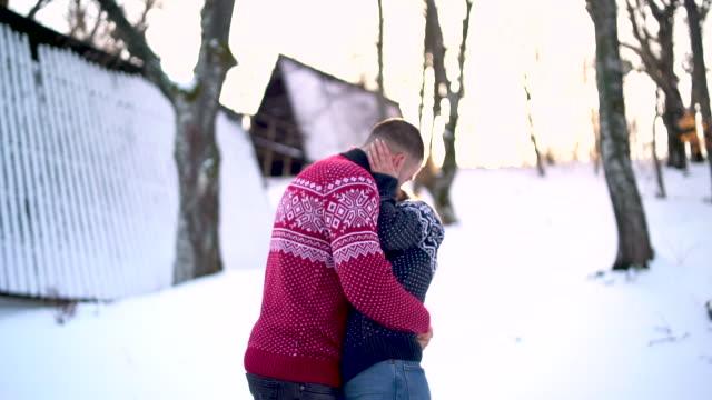 portrait of happy couple at winter resort