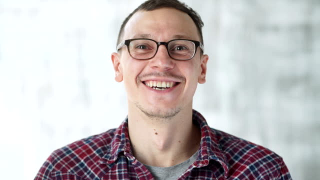 Portrait of happy handsome young man video