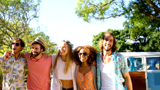 Portrait of happy hipster friends standing with arm around Portrait of happy hipster friends standing with arm around at a music festival 20 29 years stock videos & royalty-free footage