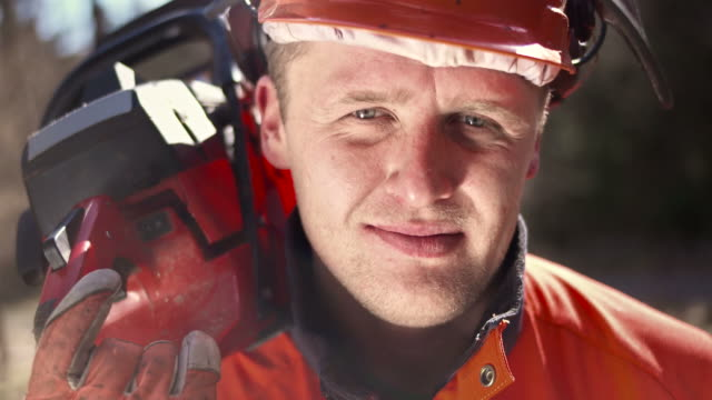 HD: Portrait Of Happy Logger With A Chainsaw video
