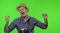 istock Portrait of happy man tourist photographer dances. Chroma key 1222115526