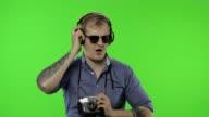 istock Portrait of happy man tourist photographer with headphones dancing. Chroma key 1222116206