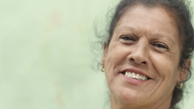 Portrait of happy old hispanic woman smiling at camera video
