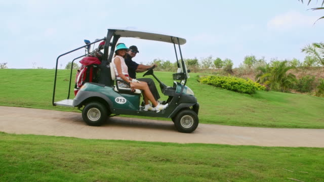 Portrait of happy people playing in golf club, sport