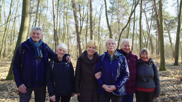portrait of happy senior friends in forest - woman portrait forest video stock e b–roll
