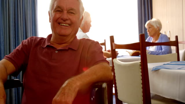 Portrait of happy senior man on wheel chair video