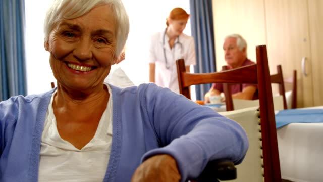 Portrait of happy senior woman on wheel chair video
