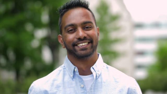 portrait of happy smiling indian man outdoors - hindus filmów i materiałów b-roll