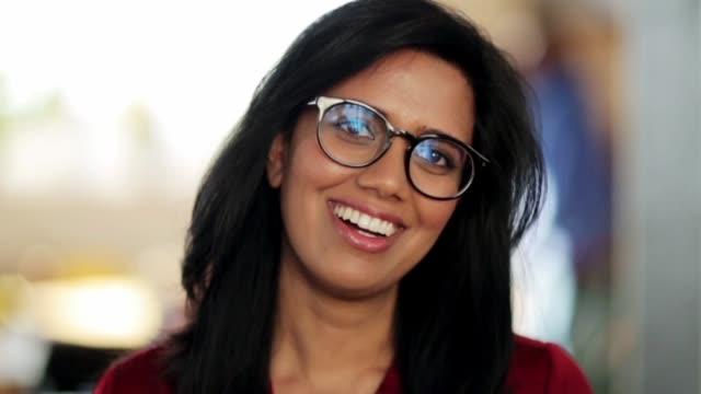 portrait of happy smiling indian woman in glasses - hindus filmów i materiałów b-roll