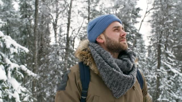 portrait of happy tourist in winter forest - abiti pesanti video stock e b–roll