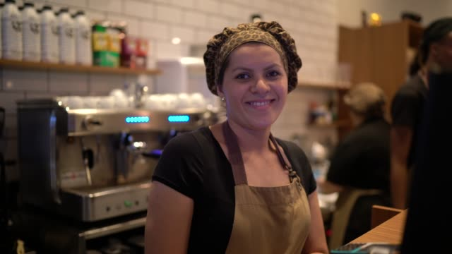 Portrait of happy waitress working Coffee shop, small business, Brazilian culture and lifestyle concept wait staff stock videos & royalty-free footage