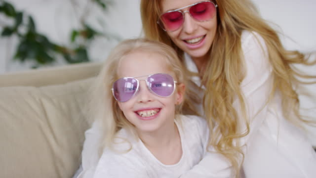 Portrait of Happy Woman and Little Girl in Sunglasses