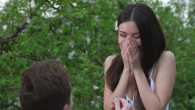 portrait of happy woman during marriage proposal - помолвка стоковые видео и кадры b-roll