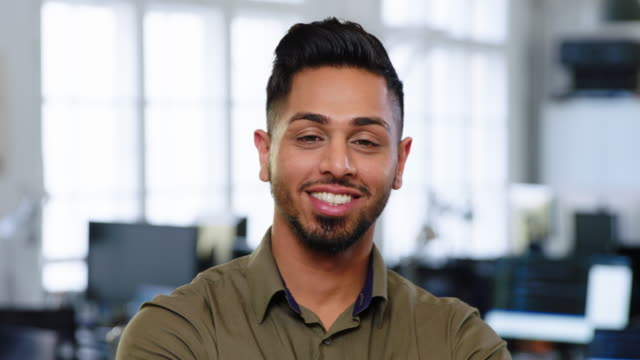 Portrait of happy young businessman Portrait of happy young businessman looking at camera. Confident indian businessman with beard in office. men stock videos & royalty-free footage
