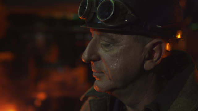 Portrait of Heavy Industry Worker in Foundry. Rough Industrial Environment. video