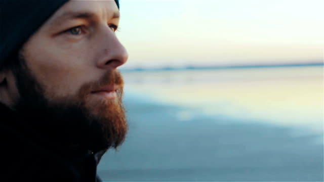 portrait of hipster beard man near the lake