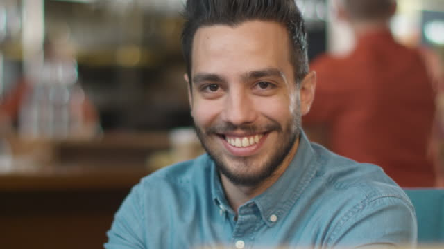 Portrait of Hispanic Ethnicity Young Man at Cozy Coffee Shop. video