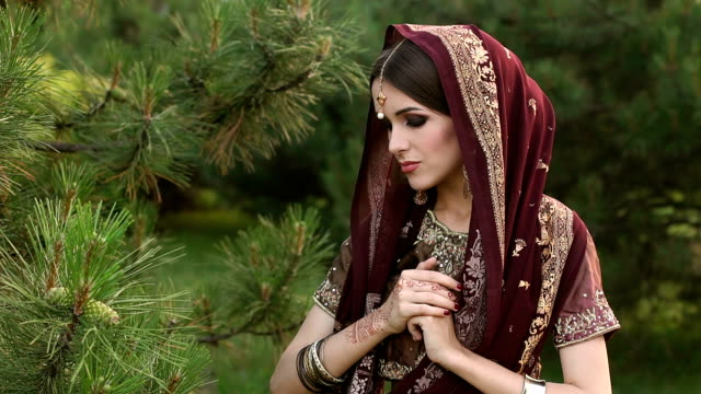 Portrait of Indian bride with covered head in Park video