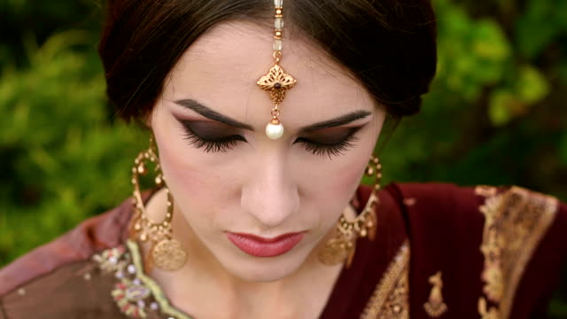 Portrait of Indian girl with kundan jewelry. video