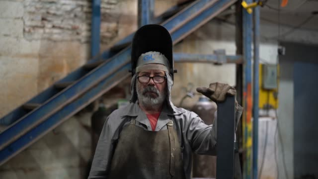 Portrait of Industrial Worker welder Business and Industry occupational safety and health stock videos & royalty-free footage