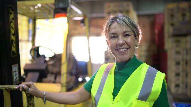 Portrait of leader woman at warehouse Portrait of leader woman at warehouse forklift stock videos & royalty-free footage